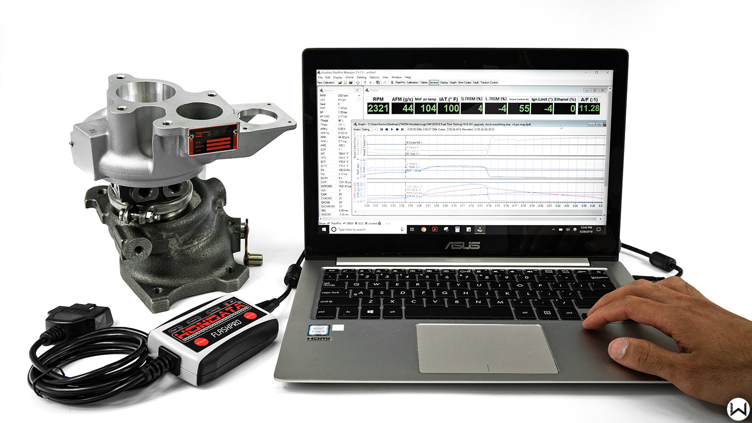 laptop-with-honda-tuning-software-next-to-drop-in-turbocharger