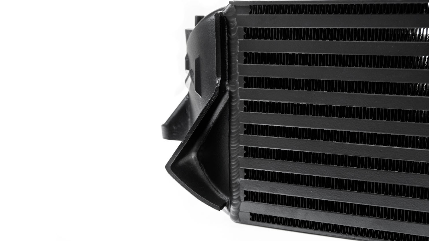 Casted air baffles on the outside of each endtank are intended to keep the air entering your grill directed through the core and radiator